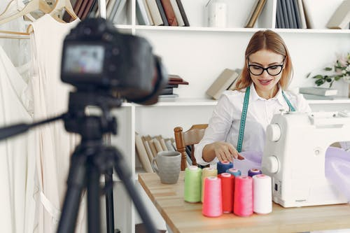 Dressmaker in front of the Camera