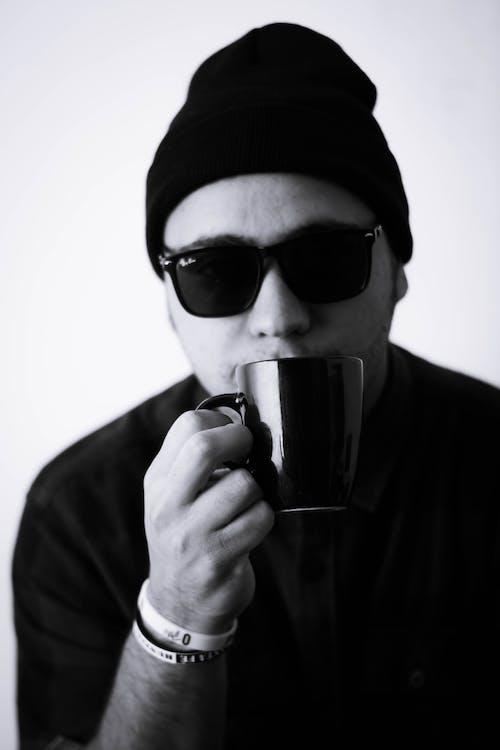 Monochrome of a Man in a Beanie Holding a Mug