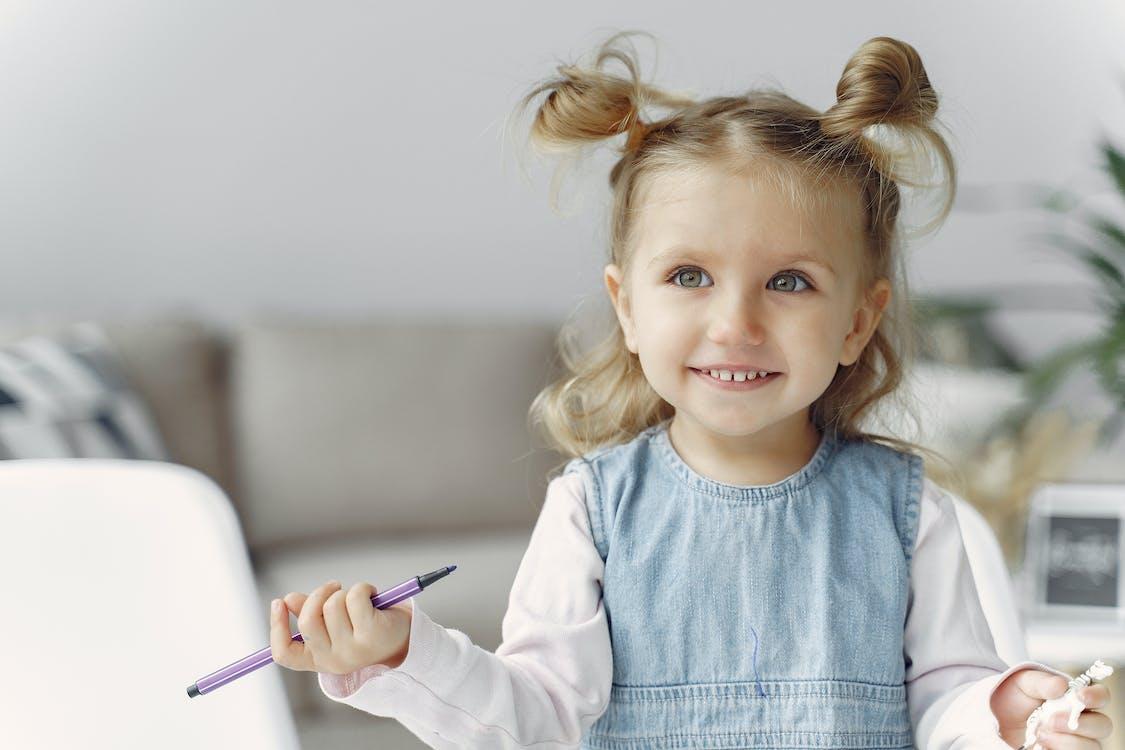 Cute Little Girl Holding Purple Color Pen