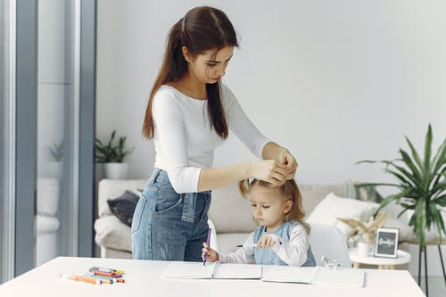 Mother Fixing Her Daughters Hair