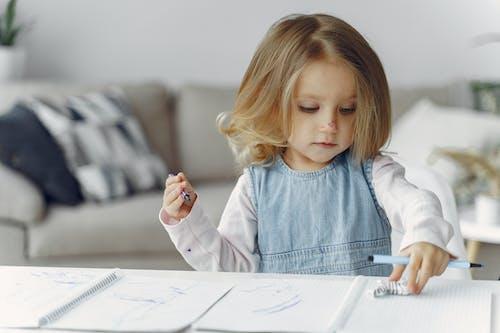 Little Girl Holding Color Pens
