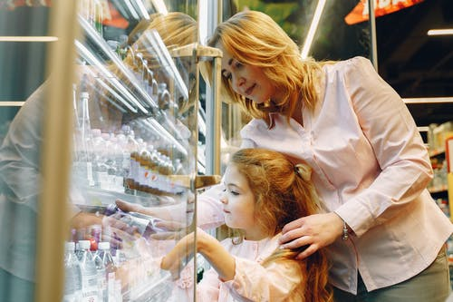 Mother Buying Her Daughter a Bottle Drink