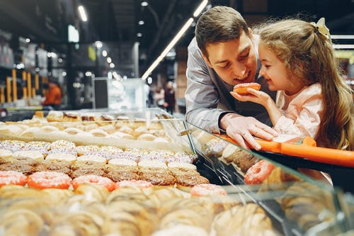 Father and Daughter Eating Donut