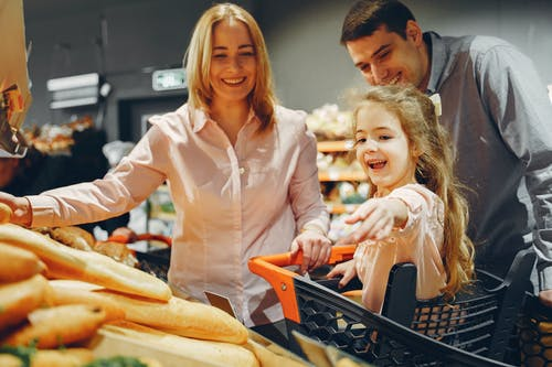 Family Doing Shopping in the Grocery Store