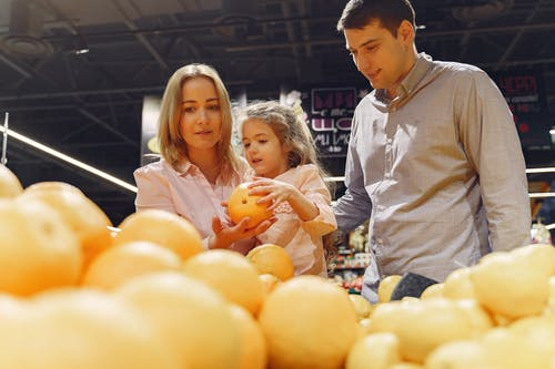 Family Buying Fresh Fruits