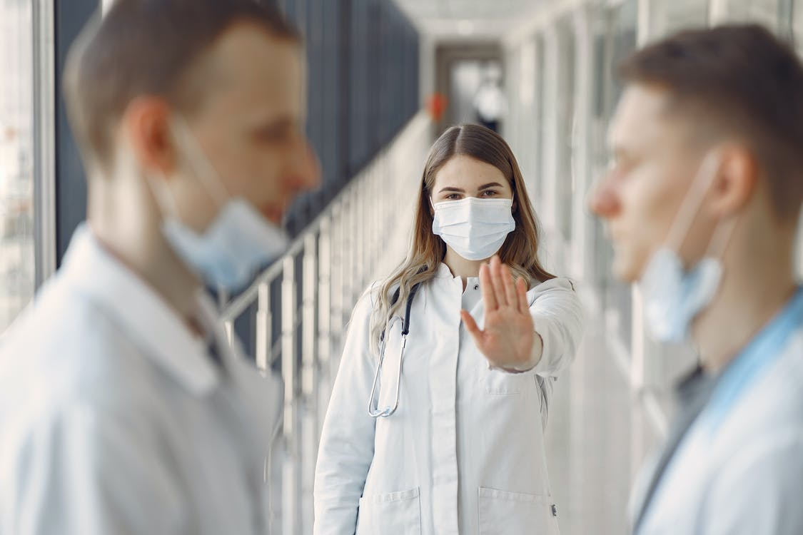 Woman Stopping Men Not Wearing Proper Face Mask