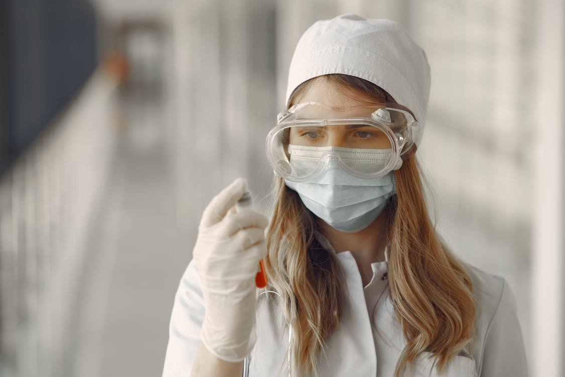 Woman in White Long Sleeve Shirt Wearing White Goggles