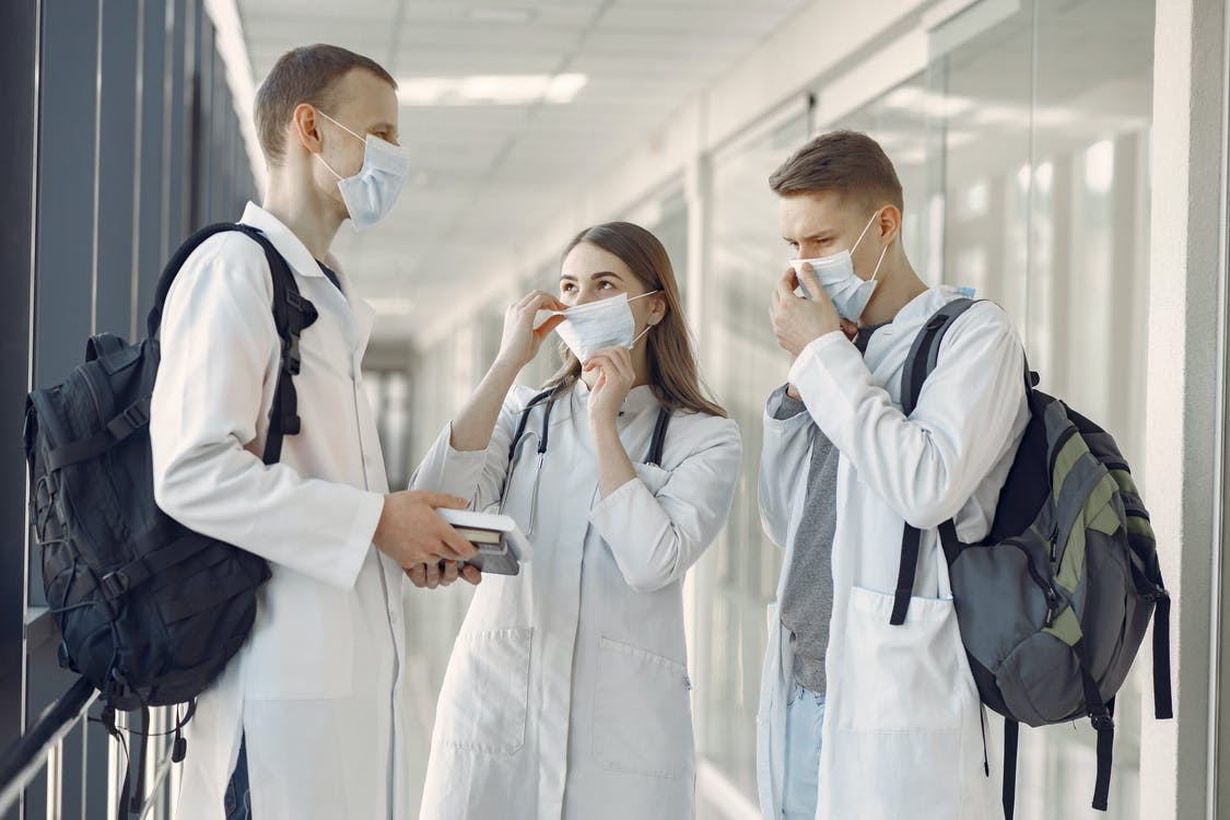 Group of Medical Students at the Hallway Wearing Face Mask