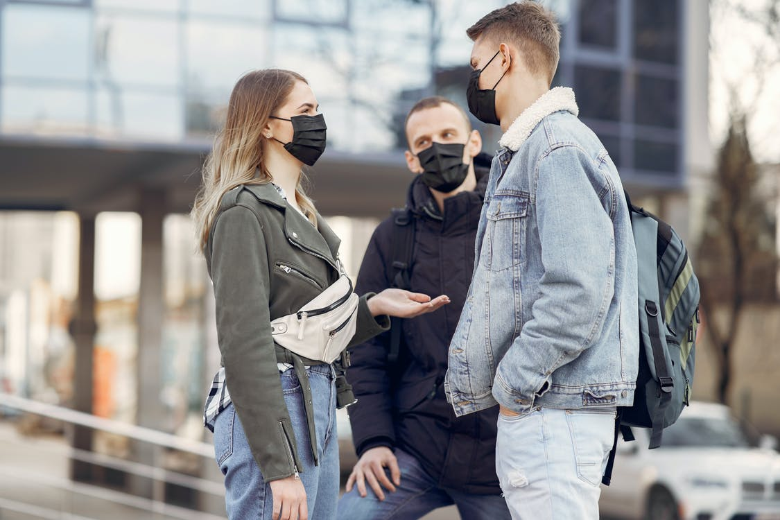 Two Men and Woman Wearing Black Face Mask