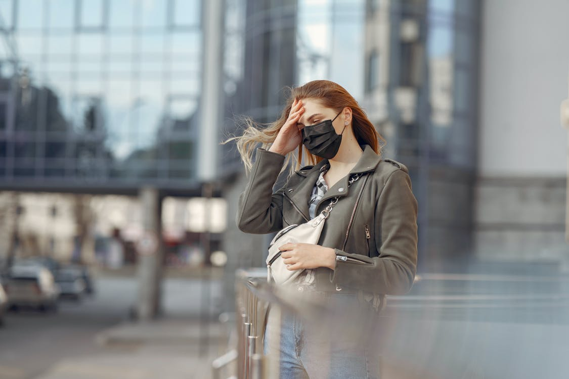Woman in Gray Coat Wearing Black Face Mask