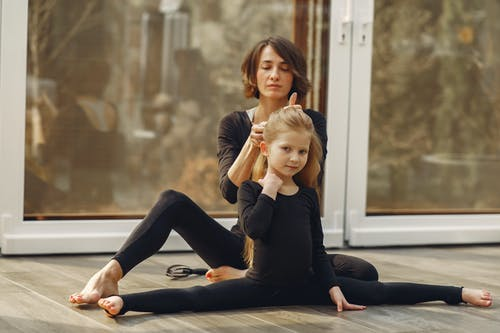 Mother and Daughter Wearing Black Tights