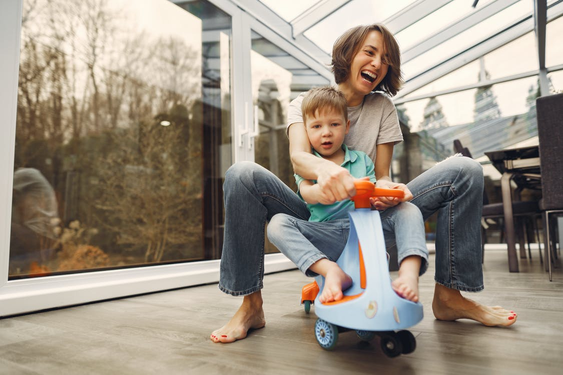 Mother and Son Riding a Twist Car