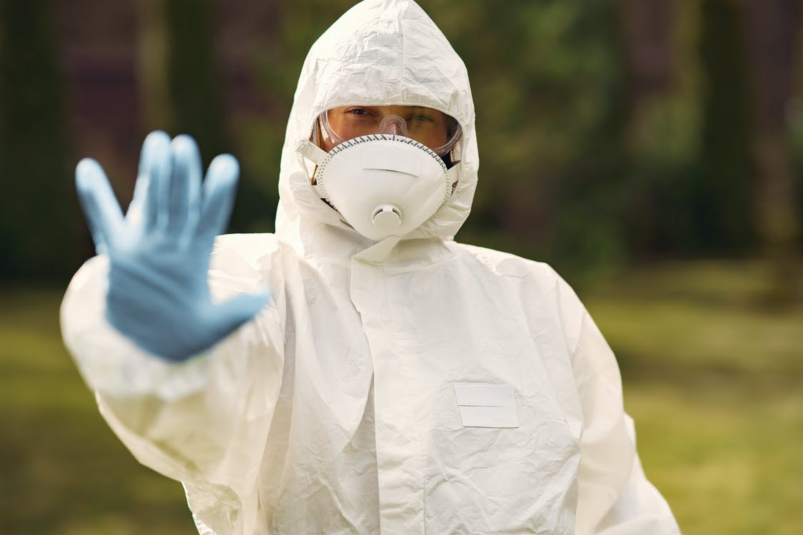 Person Wearing Protective Suit