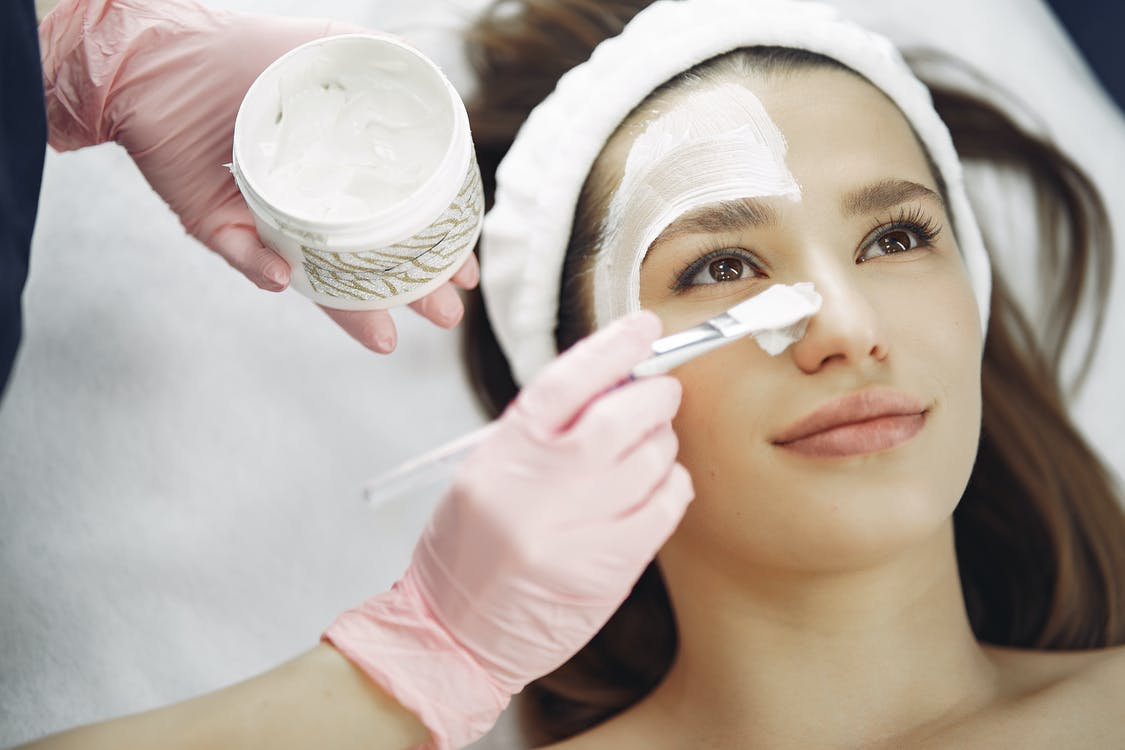 Woman With White Facial Mask