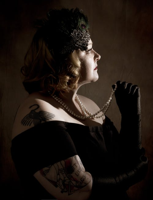 Free stock photo of 1920 s, black gown, pearls
