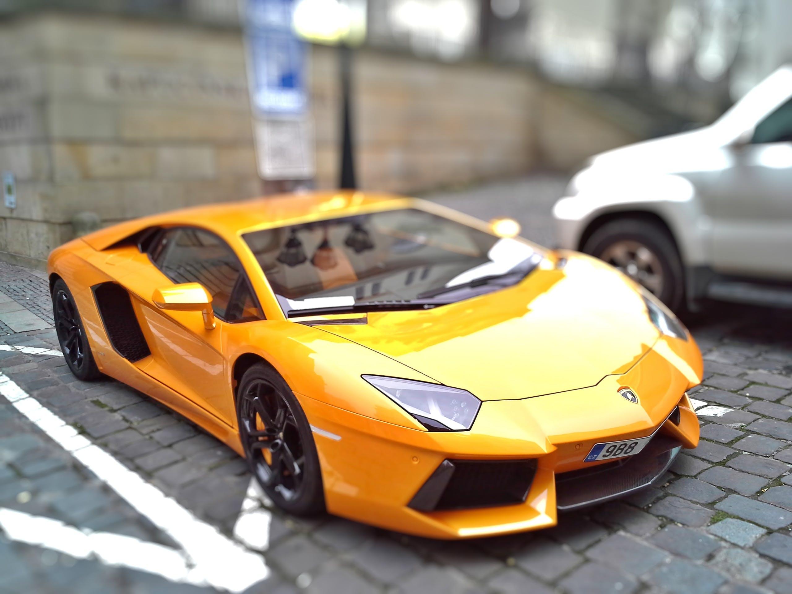 Fotos de stock gratuitas de amarillo, automotor, automóviles, cambio de inclinación