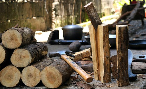 Hammer On Brown Wooden Log