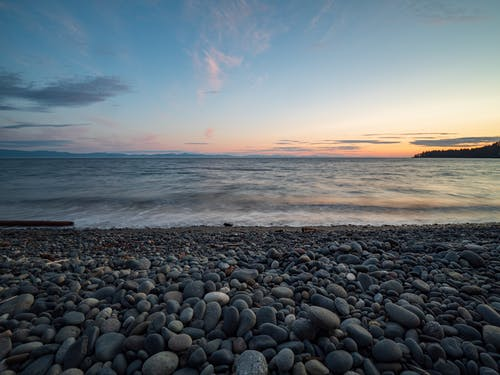 Stones On Seashore During Sunset
