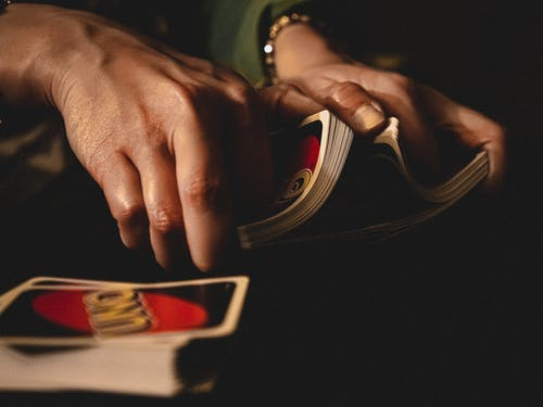 Person Shuffling Uno Cards