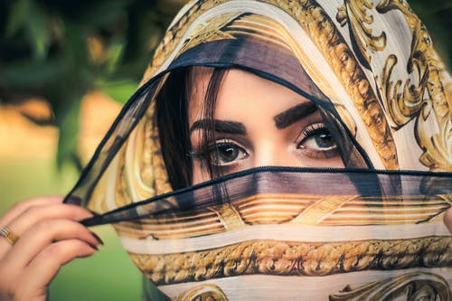 Woman With Scarf Covering Her Face