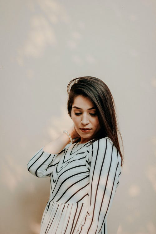 Woman In White And Black Striped Long Sleeve Clothing