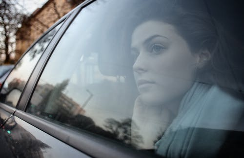 Woman Looking Out the Car Window