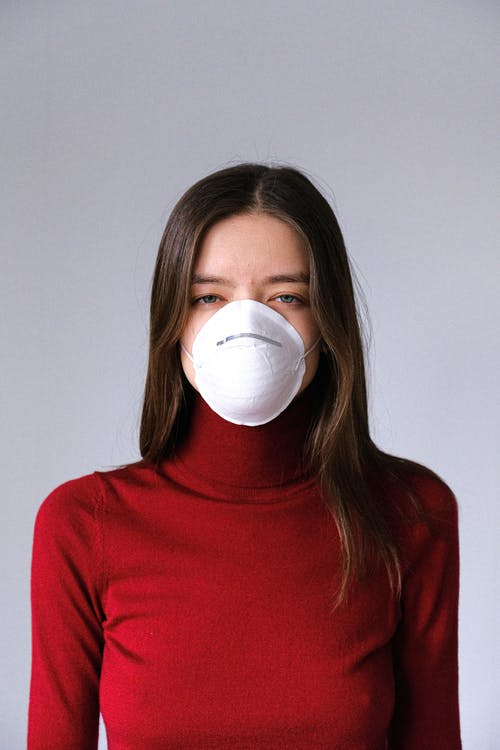 Woman in Red Turtleneck Wearing Face Mask