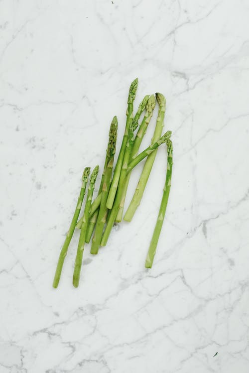 Green Asparagus on Marble Table