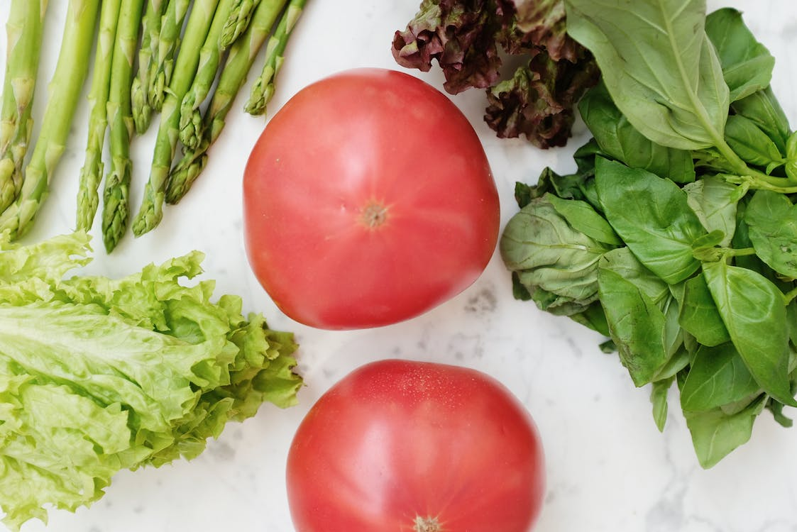 Red Tomatoes Beside Green Vegetables