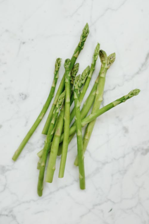 Green Asparagus on White Table