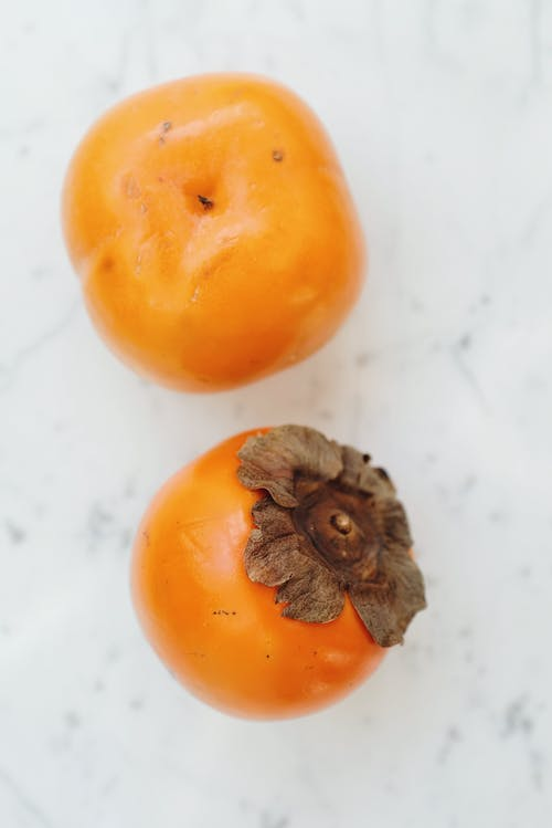Orange Persimmons on White Table
