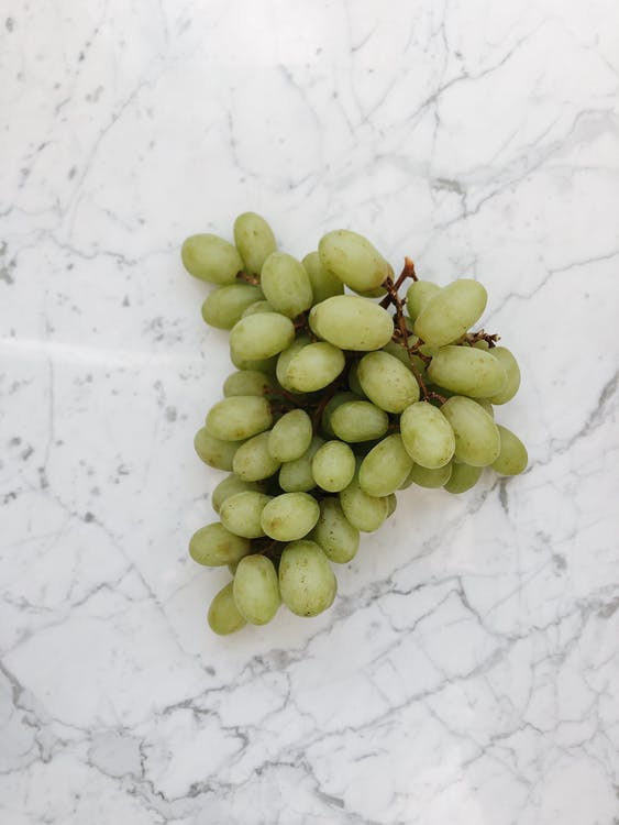 Green Grapes on Marble Table