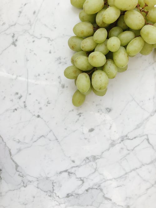 Green Grapes on White Surface