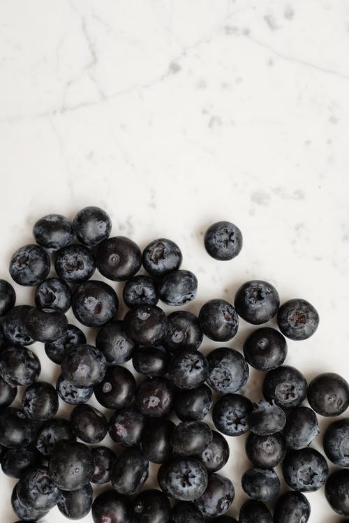 Close up of Blueberries on White Surface
