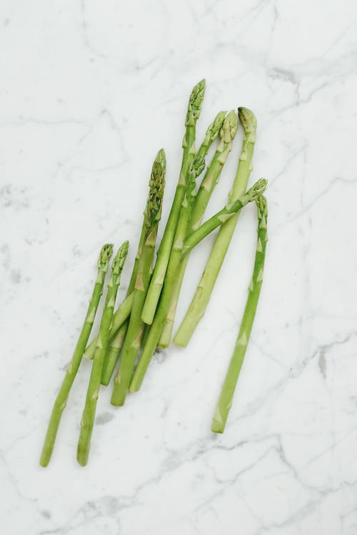 Green Asparagus on White Surface