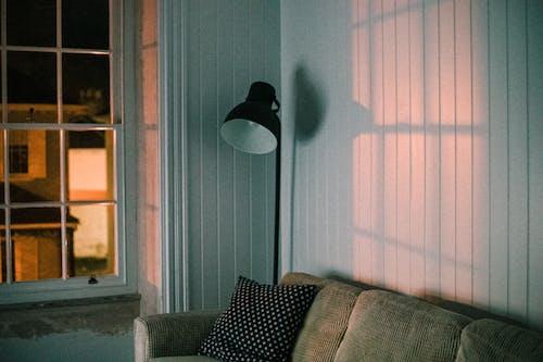 Black Floor Lamp Beside Gray Couch