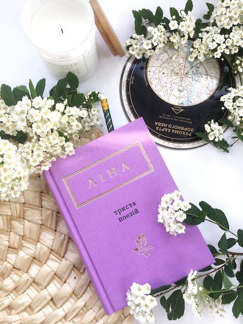 Flowers Beside A Purple Book