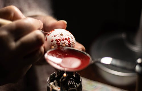 Person Using Melted Wax Making Easter Egg