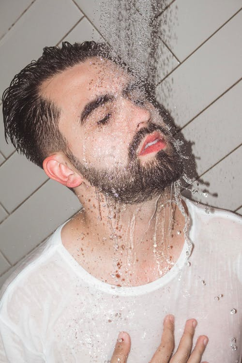 Man in White Crew Neck Shirt Taking a Shower