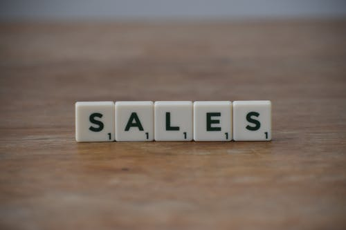 Sales Word on Wooden Table