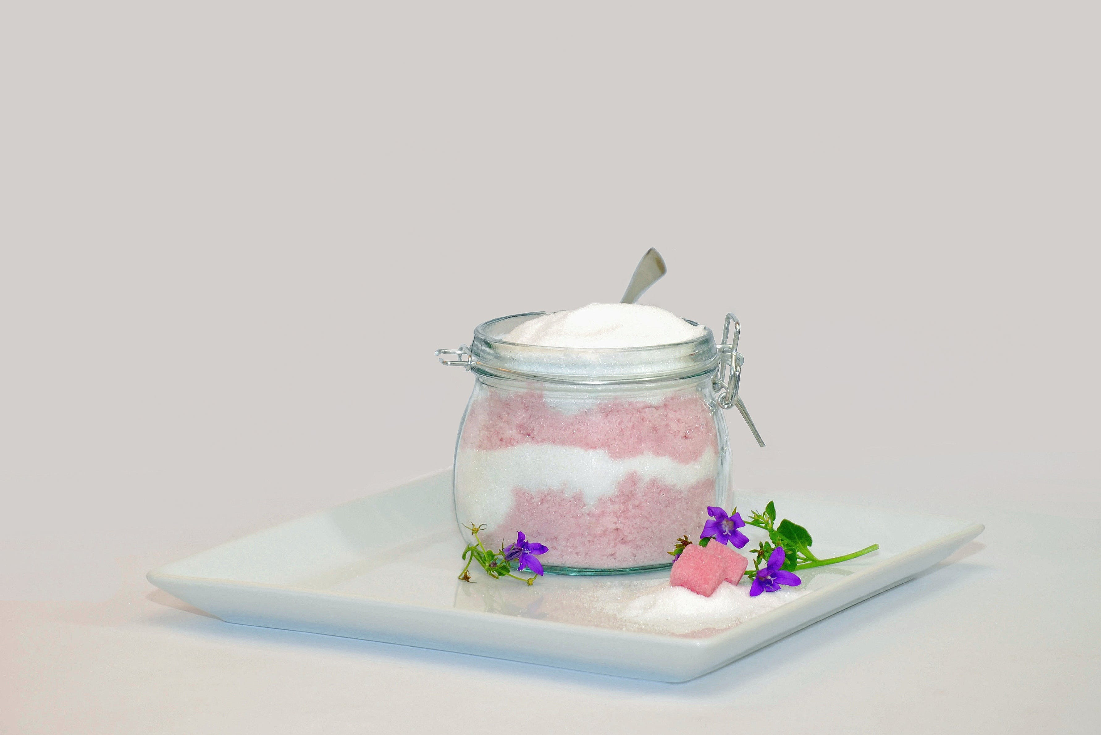 White and Pink Powders in Round Clear Glass Jar