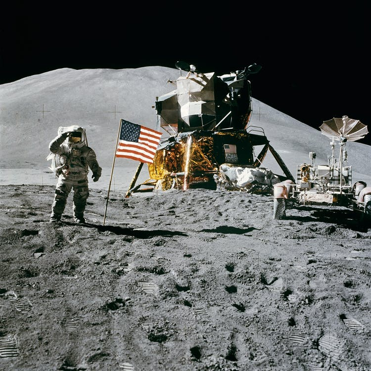 Astronaut Standing Beside American Flag on the Moon