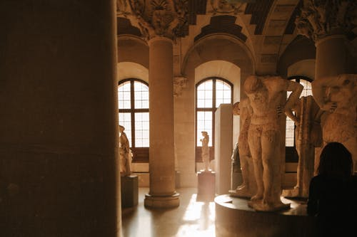 Brown Concrete Statue Inside Building