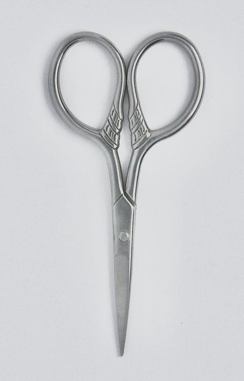 Silver Scissors on White Surface