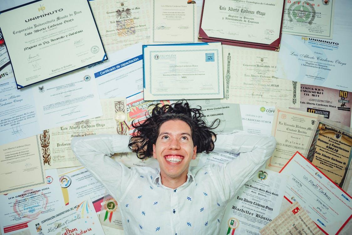 Man Lying On Certificates