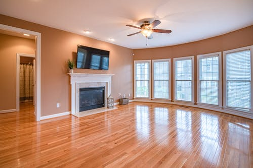 Brown 4 Blade Ceiling Fan and Wooden Flooring