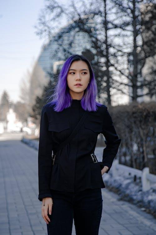 Woman in Black Coat Standing on Road