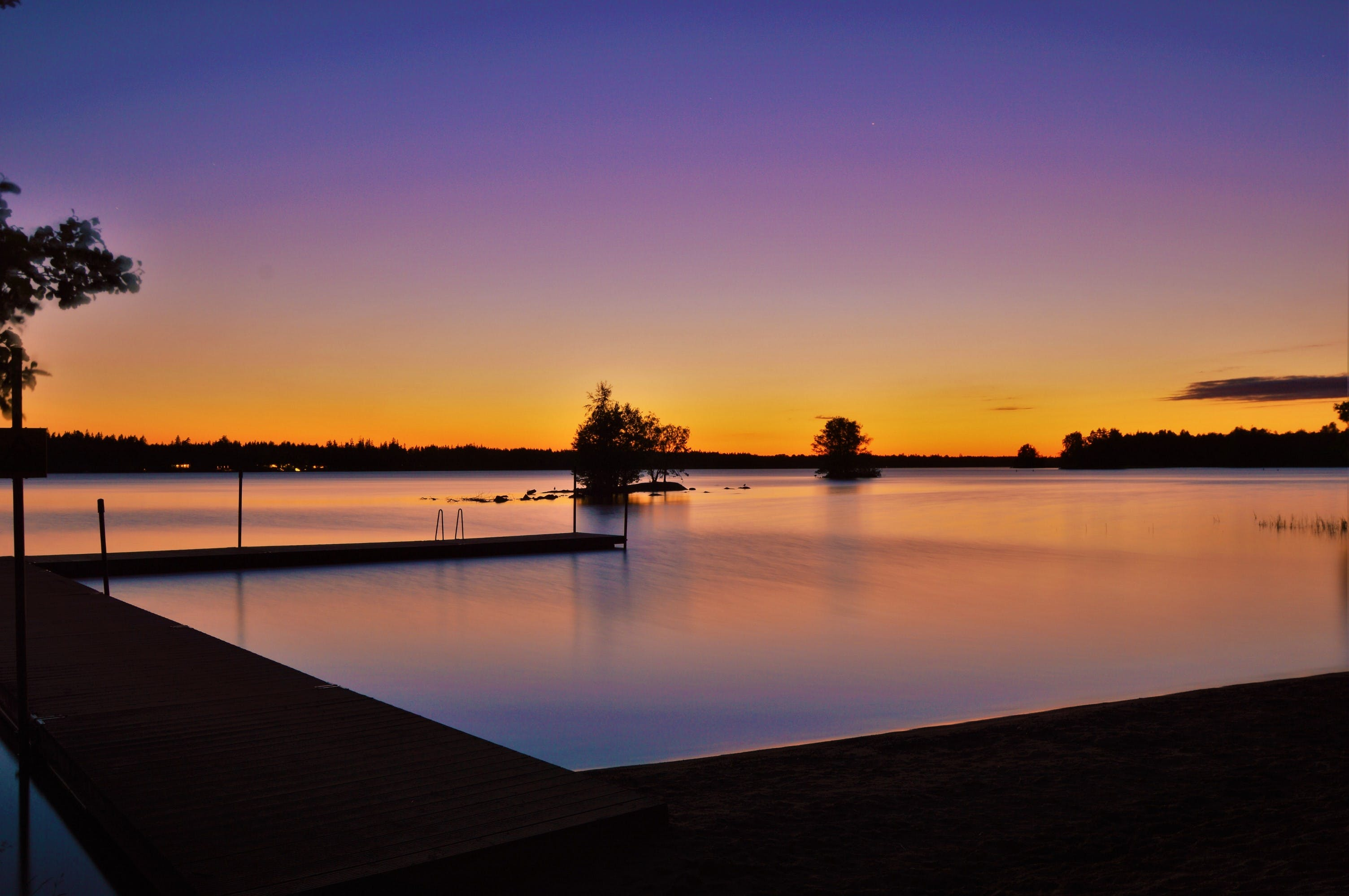Silhouette Photography of Sea Dock during Sunset