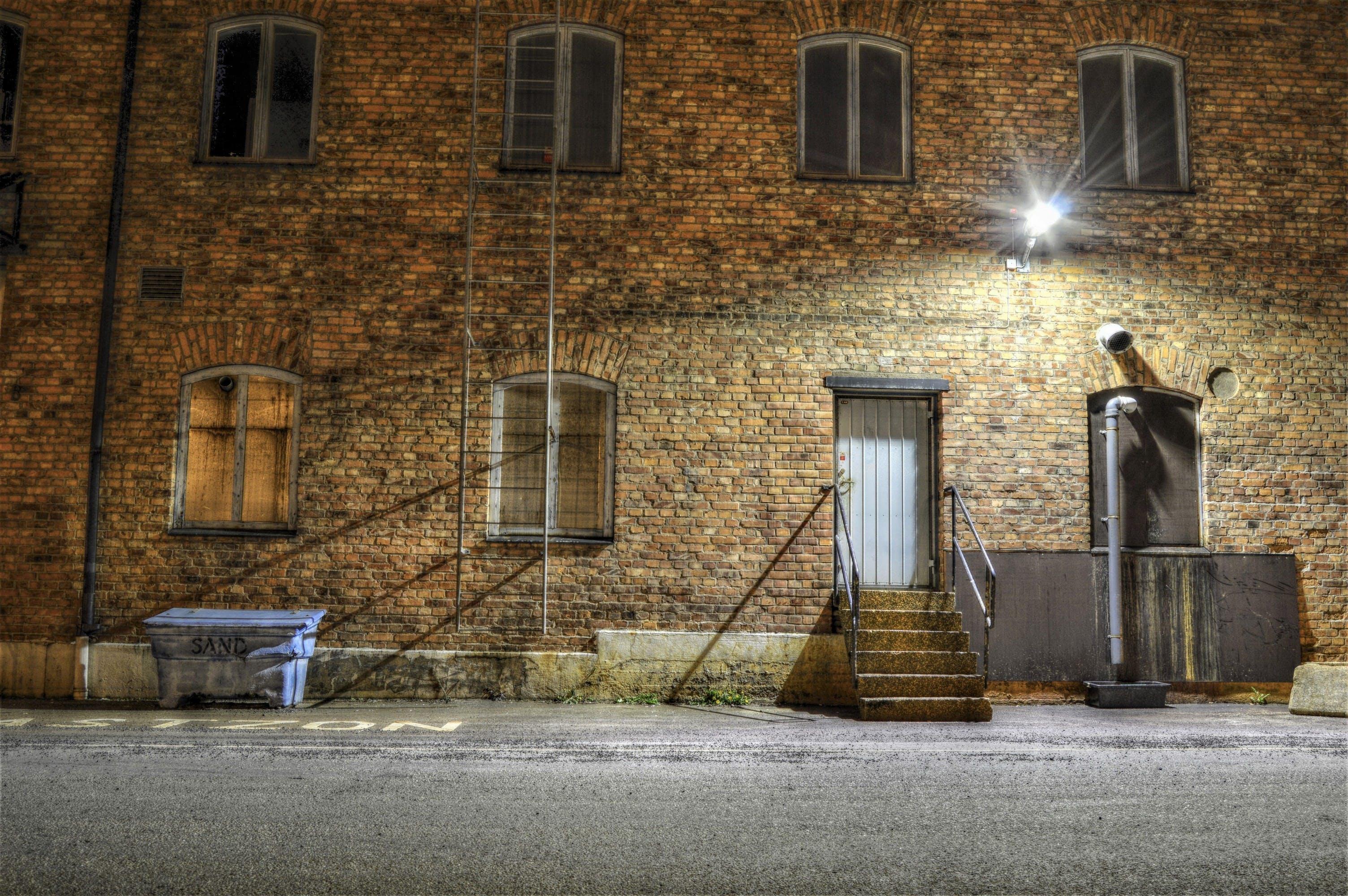 Free stock photo of brick wall, building, door, evening