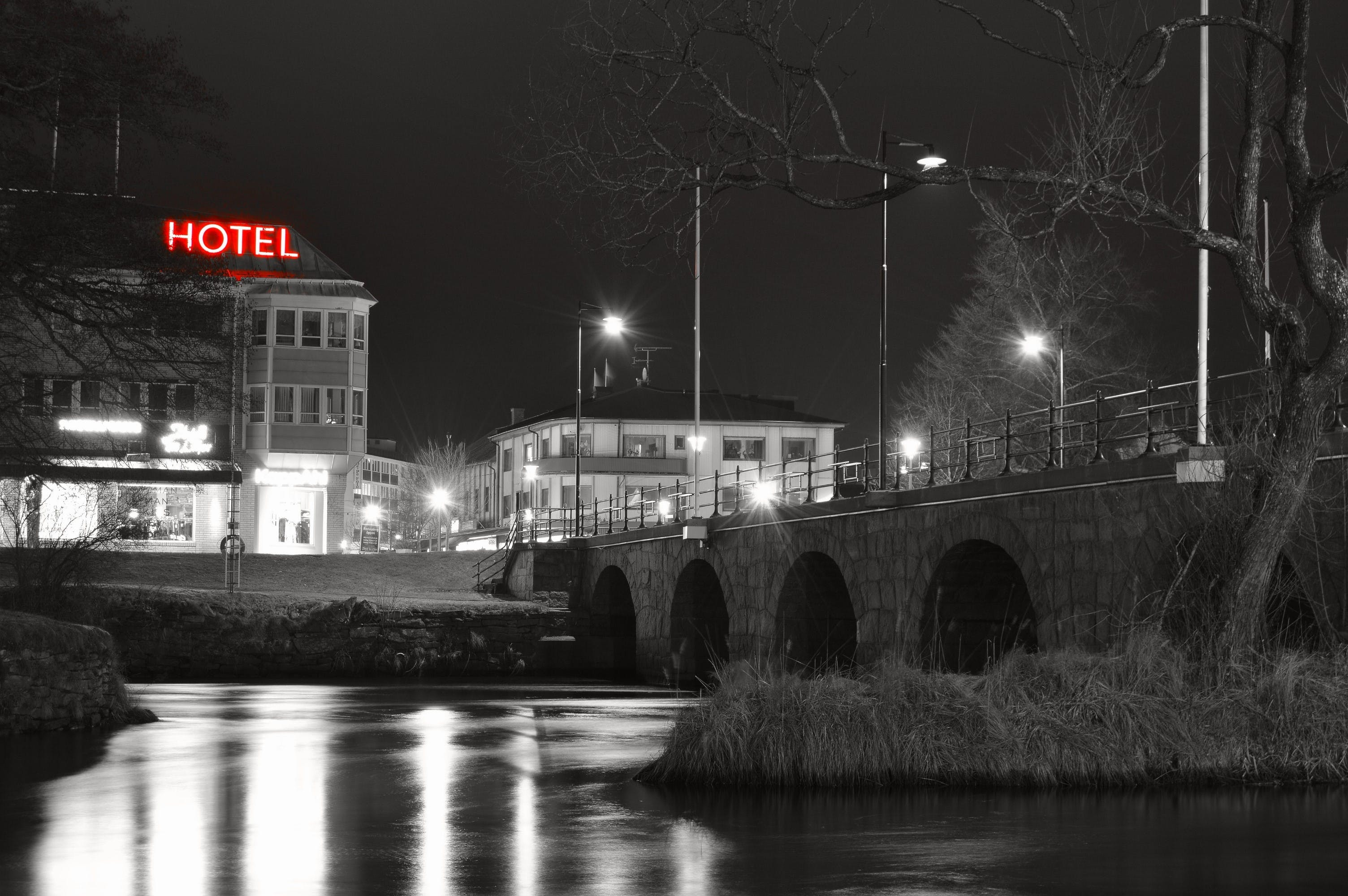 Grayscale Photo of Hotel Near River